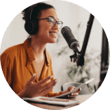 Female podcaster making audio podcast from her home
